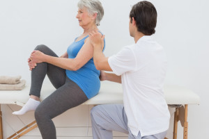 Picture of physiotherapist assisting a woman to improve her posture.